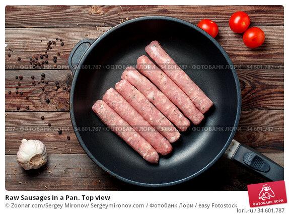 Raw Sausages in a Pan. Top view. Стоковое фото, фотограф Zoonar.com/Sergey Mironov/ Sergeymironov.com / easy Fotostock / Фотобанк Лори