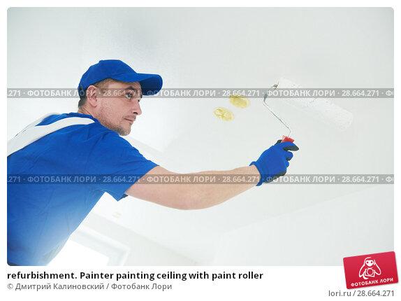 Купить «refurbishment. Painter painting ceiling with paint roller», фото № 28664271, снято 24 января 2018 г. (c) Дмитрий Калиновский / Фотобанк Лори