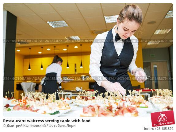 Restaurant waitress serving table with food, фото № 26185879, снято 1 декабря 2016 г. (c) Дмитрий Калиновский / Фотобанк Лори