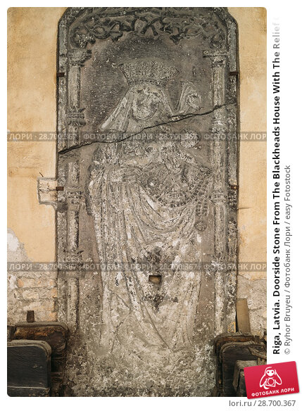 Купить «Riga, Latvia. Doorside Stone From The Blackheads House With The Relief Of St Mary In Museum Of Dome Cathedral.», фото № 28700367, снято 2 июля 2016 г. (c) easy Fotostock / Фотобанк Лори