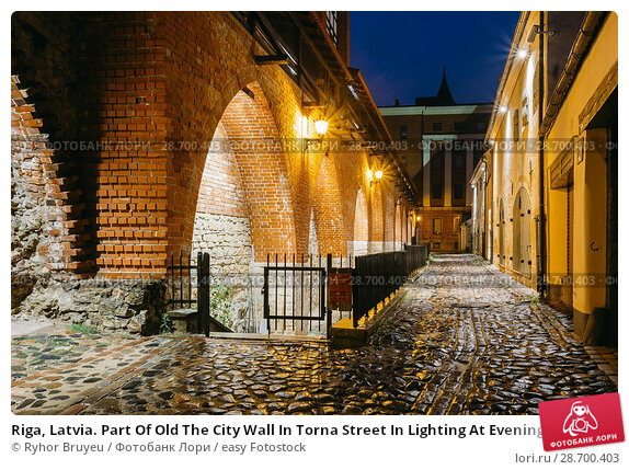 Купить «Riga, Latvia. Part Of Old The City Wall In Torna Street In Lighting At Evening Or Night Illumination In Old Town. Blue Hour.», фото № 28700403, снято 3 июля 2016 г. (c) easy Fotostock / Фотобанк Лори