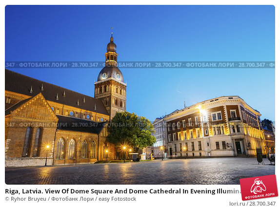 Купить «Riga, Latvia. View Of Dome Square And Dome Cathedral In Evening Illumination Under Blue Sky. Ancient Medieval Monument Of Old Town, Architectural Heritage, Famous Showplace.», фото № 28700347, снято 1 июля 2016 г. (c) easy Fotostock / Фотобанк Лори