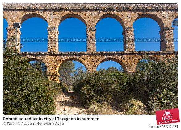 Купить «Roman aqueduct in city of Taragona in summer», фото № 28312131, снято 31 января 2018 г. (c) Татьяна Яцевич / Фотобанк Лори