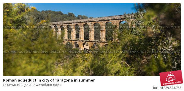 Купить «Roman aqueduct in city of Taragona in summer», фото № 29573755, снято 31 января 2018 г. (c) Татьяна Яцевич / Фотобанк Лори