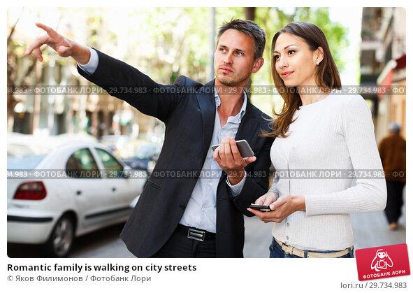 Купить «Romantic family is walking on city streets», фото № 29734983, снято 11 апреля 2017 г. (c) Яков Филимонов / Фотобанк Лори
