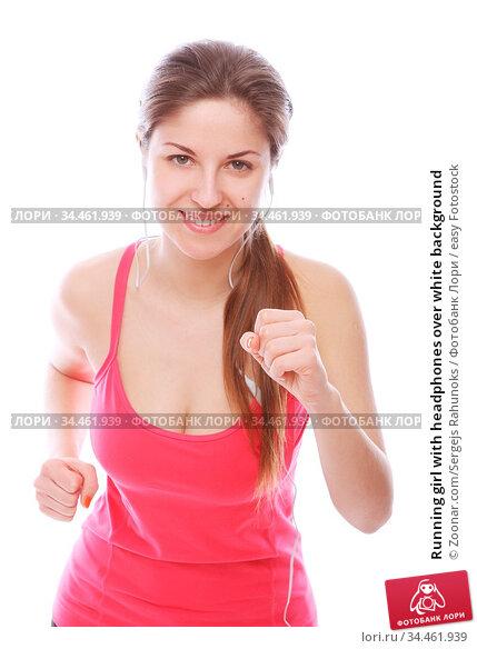 Running girl with headphones over white background. Стоковое фото, фотограф Zoonar.com/Sergejs Rahunoks / easy Fotostock / Фотобанк Лори