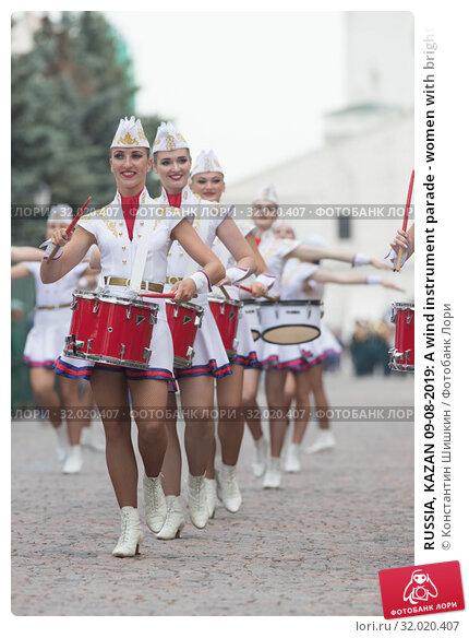 Купить «RUSSIA, KAZAN 09-08-2019: A wind instrument parade - women with bright make up in small skirts playing red drums», фото № 32020407, снято 9 августа 2019 г. (c) Константин Шишкин / Фотобанк Лори