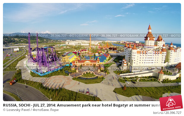RUSSIA, SOCHI - JUL 27, 2014: Amusement park near hotel Bogatyr at summer sunny day. Aerial view. Photo with noise from action camera, фото № 20396727, снято 27 июля 2014 г. (c) Losevsky Pavel / Фотобанк Лори
