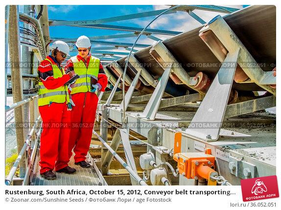 Rustenburg, South Africa, October 15, 2012, Conveyor belt transporting... Стоковое фото, фотограф Zoonar.com/Sunshine Seeds / age Fotostock / Фотобанк Лори