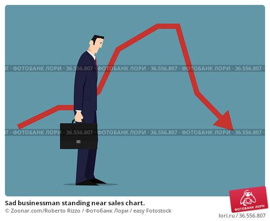 Sad businessman standing near sales chart. Стоковое фото, фотограф Zoonar.com/Roberto Rizzo / easy Fotostock / Фотобанк Лори