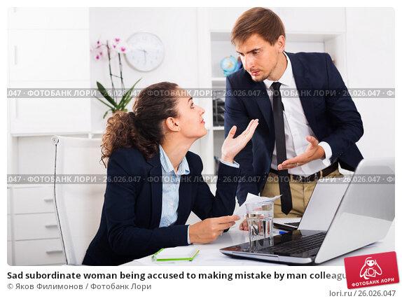 Sad subordinate woman being accused to making mistake by man colleague, фото № 26026047, снято 28 июня 2017 г. (c) Яков Филимонов / Фотобанк Лори