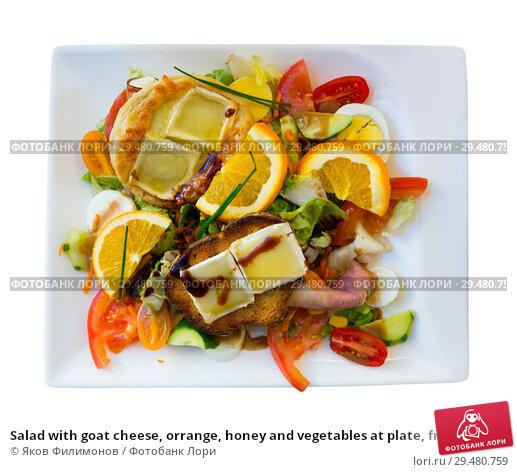 Купить «Salad with goat cheese, orrange, honey and vegetables at plate, french dish», фото № 29480759, снято 6 октября 2018 г. (c) Яков Филимонов / Фотобанк Лори