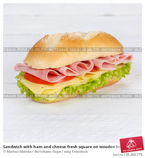 Sandwich with ham and cheese fresh square on wooden board wood. Стоковое фото, фотограф Markus Mainka / easy Fotostock / Фотобанк Лори