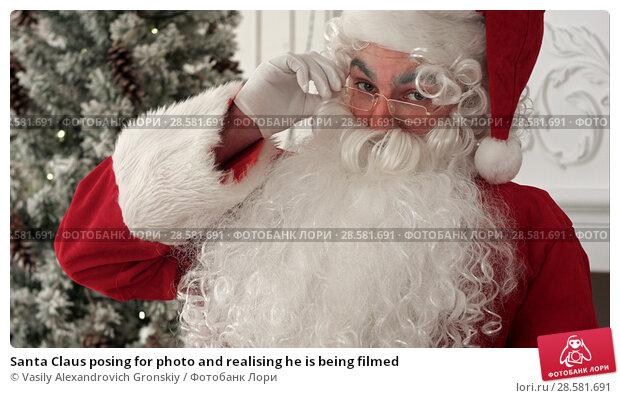 Купить «Santa Claus posing for photo and realising he is being filmed», фото № 28581691, снято 19 июня 2018 г. (c) Vasily Alexandrovich Gronskiy / Фотобанк Лори