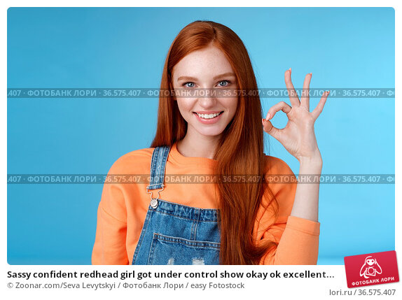 Sassy confident redhead girl got under control show okay ok excellent... Стоковое фото, фотограф Zoonar.com/Seva Levytskyi / easy Fotostock / Фотобанк Лори