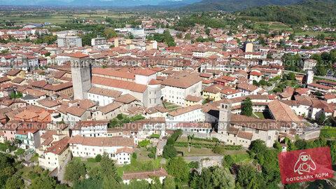 Купить «Scenic aerial view of historic centre of Cividale del Friuli on Natisone river with medieval stone Devil Bridge and Cathedral parish church, Italy», видеоролик № 32251687, снято 3 сентября 2019 г. (c) Яков Филимонов / Фотобанк Лори