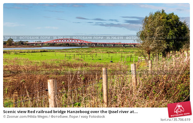 Scenic view Red railroad bridge Hanzeboog over the IJssel river at... Стоковое фото, фотограф Zoonar.com/Hilda Weges / easy Fotostock / Фотобанк Лори