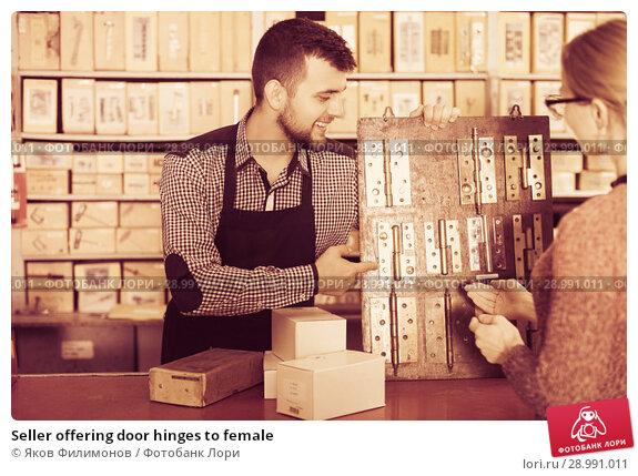 Купить «Seller offering door hinges to female», фото № 28991011, снято 5 апреля 2017 г. (c) Яков Филимонов / Фотобанк Лори