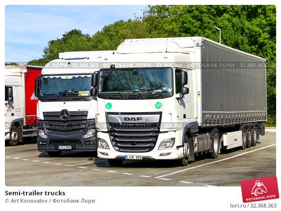 Купить «Semi-trailer trucks», фото № 32368363, снято 14 сентября 2019 г. (c) Art Konovalov / Фотобанк Лори