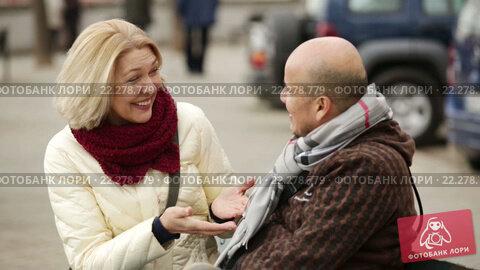 Купить «Senior family couple walking at city street in autumn day», видеоролик № 22278779, снято 15 марта 2016 г. (c) Яков Филимонов / Фотобанк Лори