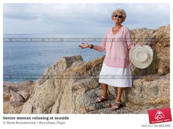 Senior woman relaxing at seaside. Стоковое фото, фотограф Яков Филимонов / Фотобанк Лори