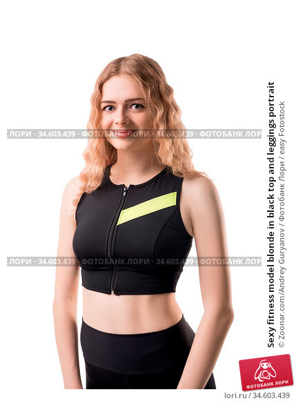 Sexy fitness model blonde in black top and leggings portrait. Стоковое фото, фотограф Zoonar.com/Andrey Guryanov / easy Fotostock / Фотобанк Лори