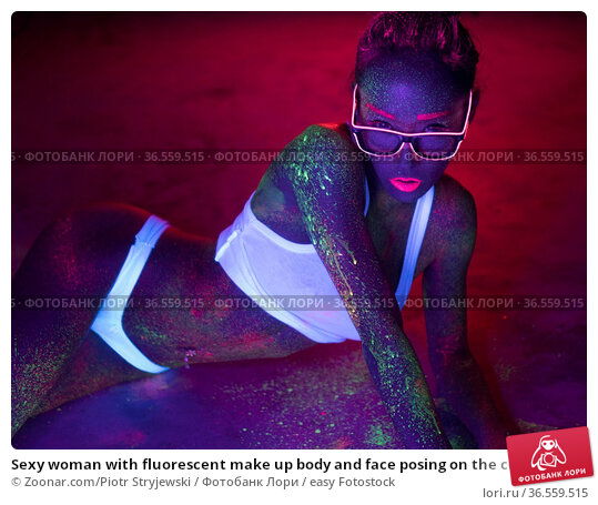 Sexy woman with fluorescent make up body and face posing on the concrete... Стоковое фото, фотограф Zoonar.com/Piotr Stryjewski / easy Fotostock / Фотобанк Лори