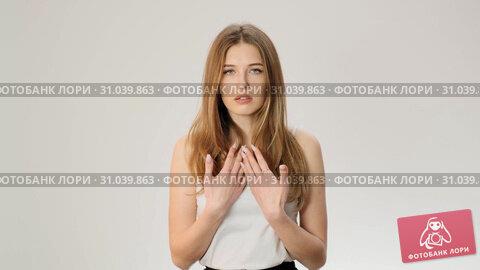 Shoked surprised female model looking at camera with astonishment slow motion. Стоковое видео, видеограф Denis Mishchenko / Фотобанк Лори