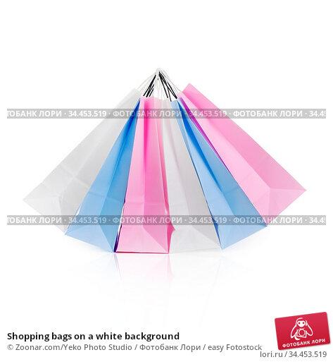Shopping bags on a white background. Стоковое фото, фотограф Zoonar.com/Yeko Photo Studio / easy Fotostock / Фотобанк Лори