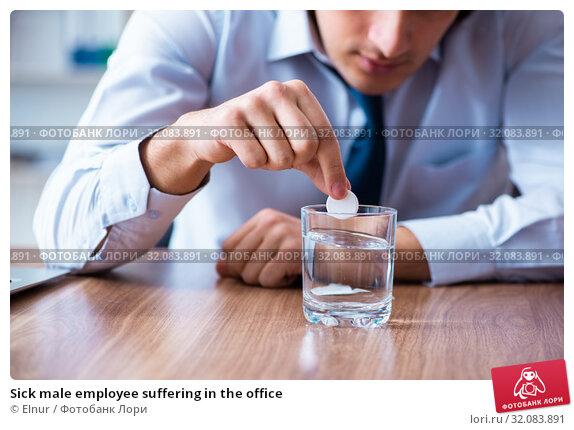Sick male employee suffering in the office. Стоковое фото, фотограф Elnur / Фотобанк Лори