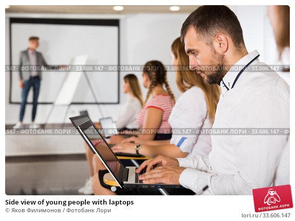 Купить «Side view of young people with laptops», фото № 33606147, снято 25 июля 2018 г. (c) Яков Филимонов / Фотобанк Лори