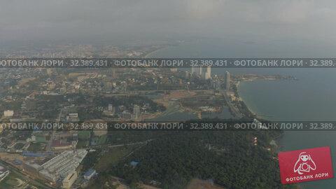 Купить «Sihanoukville city in Cambodia drone shot 4K», видеоролик № 32389431, снято 26 октября 2019 г. (c) Aleksejs Bergmanis / Фотобанк Лори