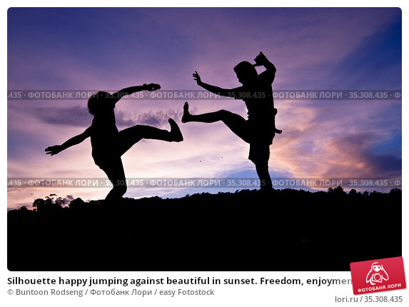 Silhouette happy jumping against beautiful in sunset. Freedom, enjoyment... Стоковое фото, фотограф Buntoon Rodseng / easy Fotostock / Фотобанк Лори