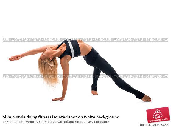 Slim blonde doing fitness isolated shot on white background. Стоковое фото, фотограф Zoonar.com/Andrey Guryanov / easy Fotostock / Фотобанк Лори