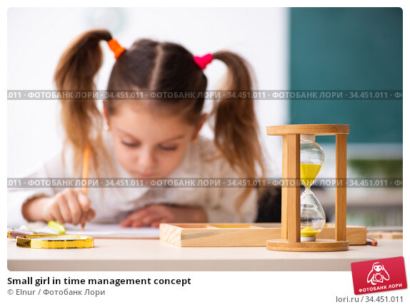 Small girl in time management concept. Стоковое фото, фотограф Elnur / Фотобанк Лори