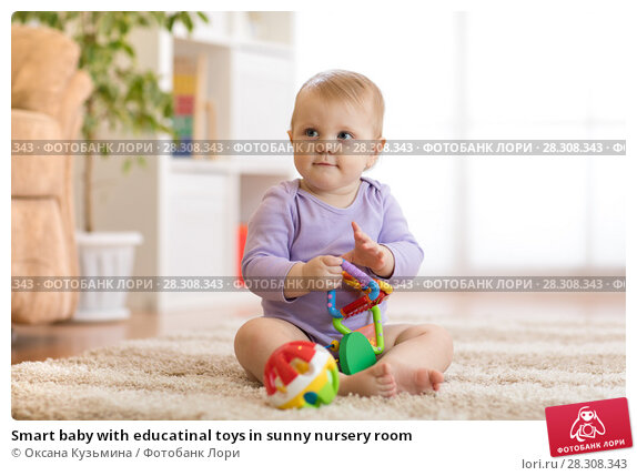 Купить «Smart baby with educatinal toys in sunny nursery room», фото № 28308343, снято 21 августа 2018 г. (c) Оксана Кузьмина / Фотобанк Лори