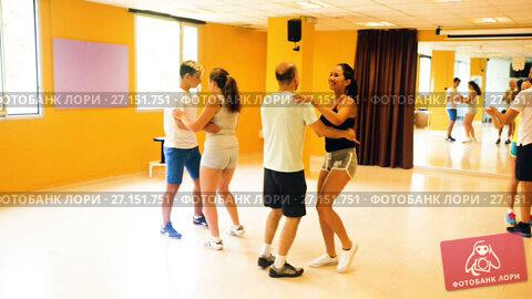 Купить «Smiling adults dancing salsa together in dance studio», видеоролик № 27151751, снято 6 июля 2017 г. (c) Яков Филимонов / Фотобанк Лори