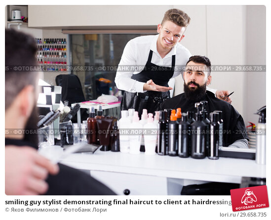 Купить «smiling guy stylist demonstrating final haircut to client at hairdressing salon», фото № 29658735, снято 27 января 2017 г. (c) Яков Филимонов / Фотобанк Лори