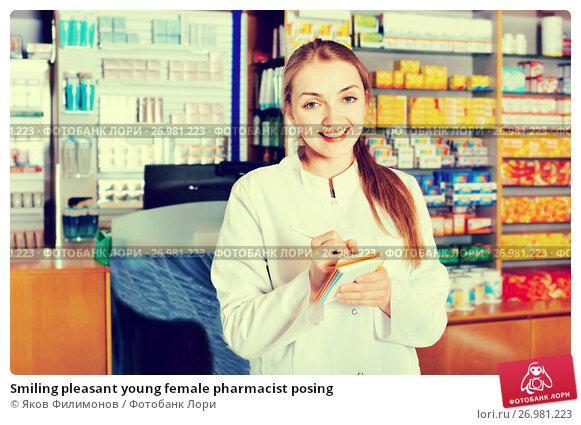 Smiling pleasant young female pharmacist posing, фото № 26981223, снято 18 октября 2017 г. (c) Яков Филимонов / Фотобанк Лори
