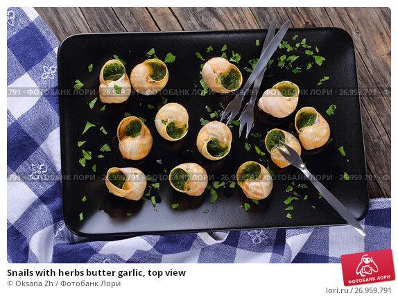 Купить «Snails with herbs butter garlic, top view», фото № 26959791, снято 30 июля 2017 г. (c) Oksana Zh / Фотобанк Лори