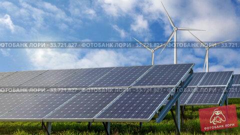 Купить «Solar panels and wind turbines as the renewable resources of energy.», видеоролик № 33721827, снято 4 июля 2020 г. (c) Ярослав Данильченко / Фотобанк Лори