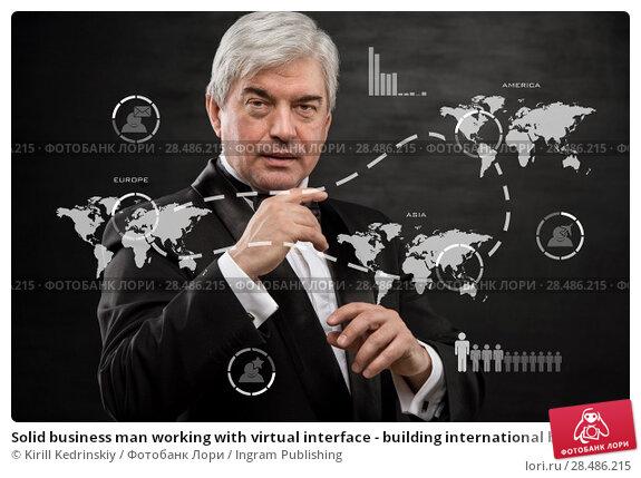 Купить «Solid business man working with virtual interface - building international business», фото № 28486215, снято 28 января 2013 г. (c) Ingram Publishing / Фотобанк Лори