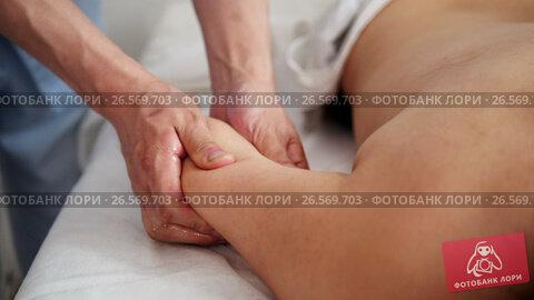 Купить «Spa. The hands of the massage therapist make a massage on the arm», видеоролик № 26569703, снято 2 декабря 2018 г. (c) Константин Шишкин / Фотобанк Лори