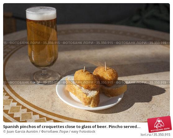 Spanish pinchos of croquettes close to glass of beer. Pincho served... Стоковое фото, фотограф Juan García Aunión / easy Fotostock / Фотобанк Лори