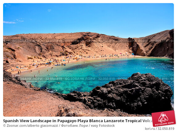 Spanish View Landscape in Papagayo Playa Blanca Lanzarote Tropical Volcanic Canary Islands Spain. Стоковое фото, фотограф Zoonar.com/alberto giacomazzi / easy Fotostock / Фотобанк Лори