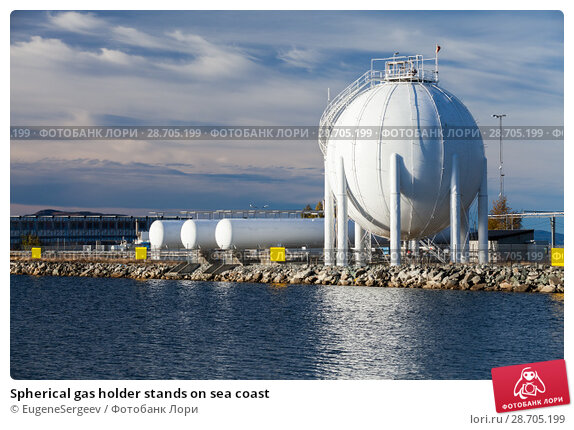 Купить «Spherical gas holder stands on sea coast», фото № 28705199, снято 16 октября 2016 г. (c) EugeneSergeev / Фотобанк Лори