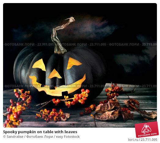 Купить «Spooky pumpkin on table with leaves», фото № 23711095, снято 29 октября 2013 г. (c) easy Fotostock / Фотобанк Лори