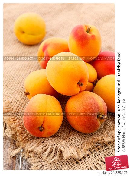 Купить «Stack of apricots on jute background. Healthy food», фото № 21835107, снято 21 апреля 2019 г. (c) BE&W Photo / Фотобанк Лори