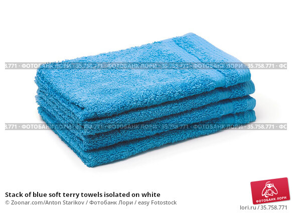 Stack of blue soft terry towels isolated on white. Стоковое фото, фотограф Zoonar.com/Anton Starikov / easy Fotostock / Фотобанк Лори