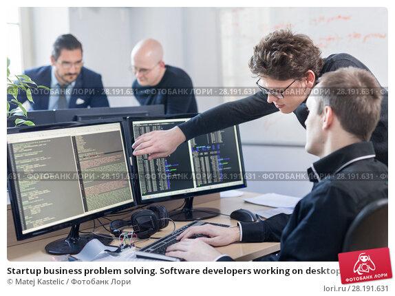 Startup business problem solving. Software developers working on desktop computer. Стоковое фото, фотограф Matej Kastelic / Фотобанк Лори